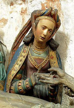 Estátua de Maria Madalena ao lado de Jesus crucificado (Crédito: Reprodução)